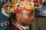 Chiefs in Eleme are responsible for presiding over different parts of the territory. Emere Emeperor Nkpe dons a contemporary ceremonial hat associated with his status in the community.