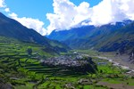 In the upper valley of Manang district, the village of Thulo Manang sits on a raised plateau surrounded by farmland on which buckwheat and potatoes are grown.